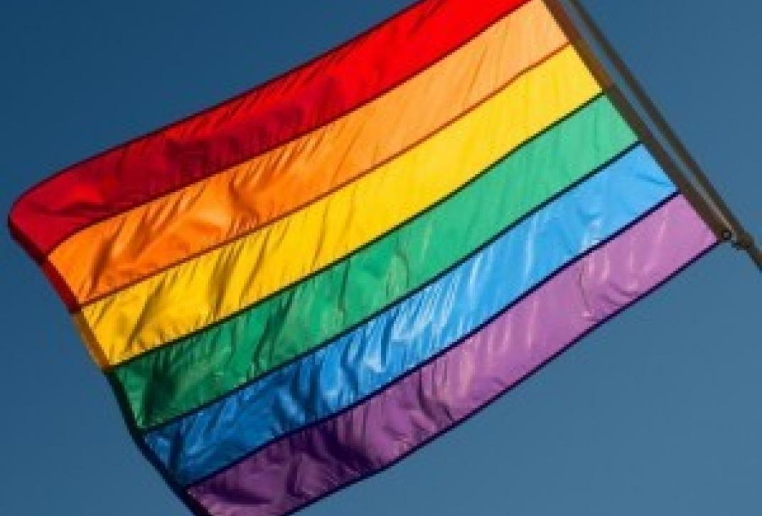 rainbow flag on blue sky