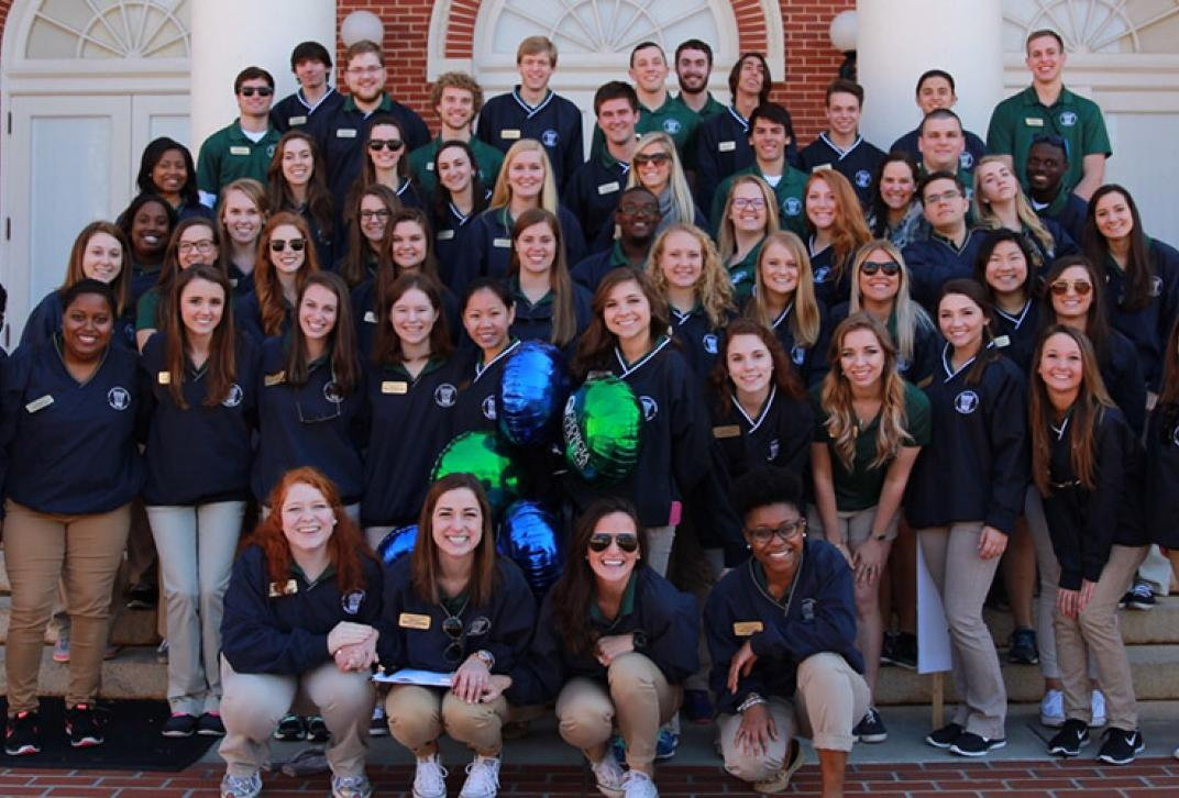 council of student ambassadors group shot on front steps