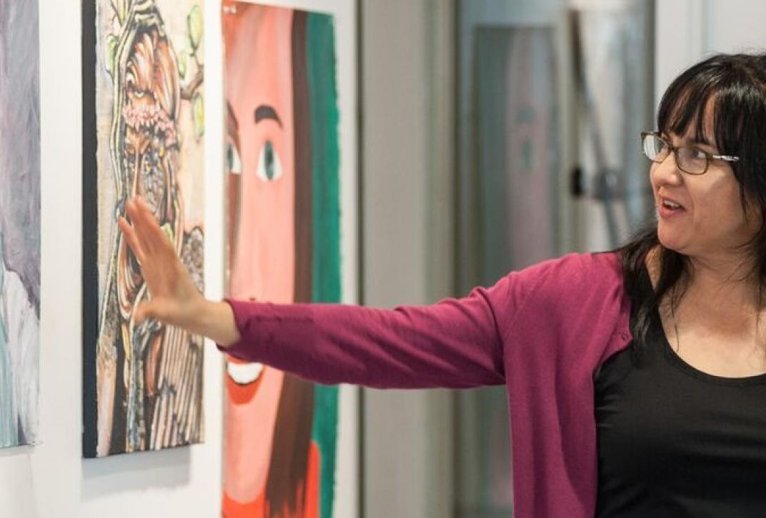 faculty explaining art in gallery
