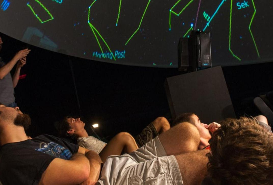 students in planetarium