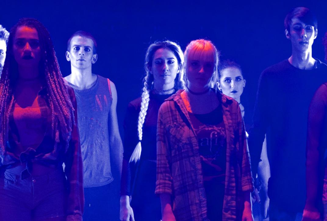 students on stage in blue lighting