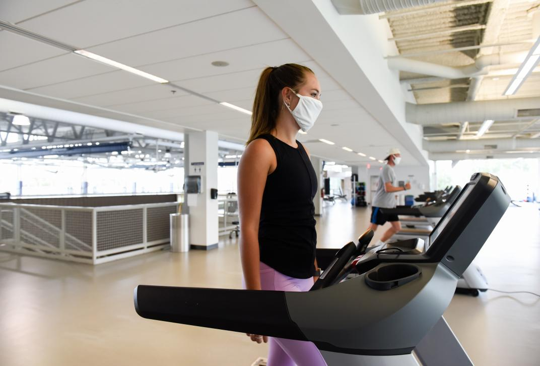 girl on treadmill in mask