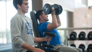 Two GC students using dumbells at WRC