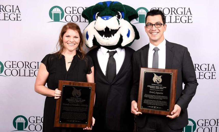 alumni receiving awards with mascot