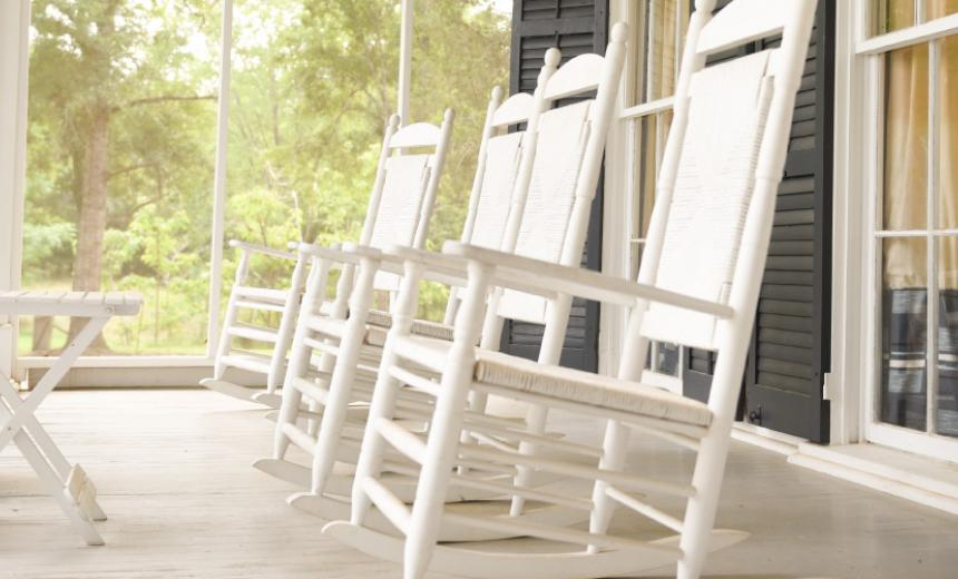 white rocking chairs on porch