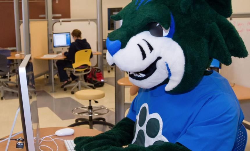 mascot registering at computer in lab