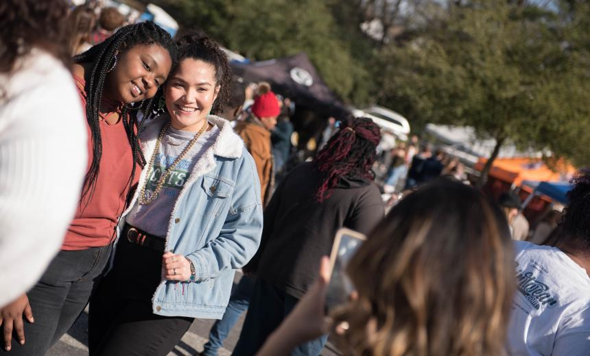 two female students pose for a photo at Homecoming 2019.