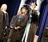 student on stage at graduation ceremony
