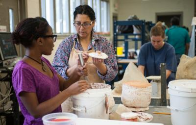faculty and student working on an art project