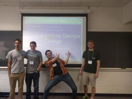 math team win in front of projector