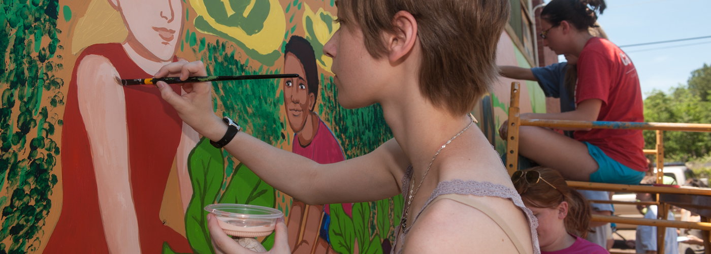 students painting mural in Hardwick community