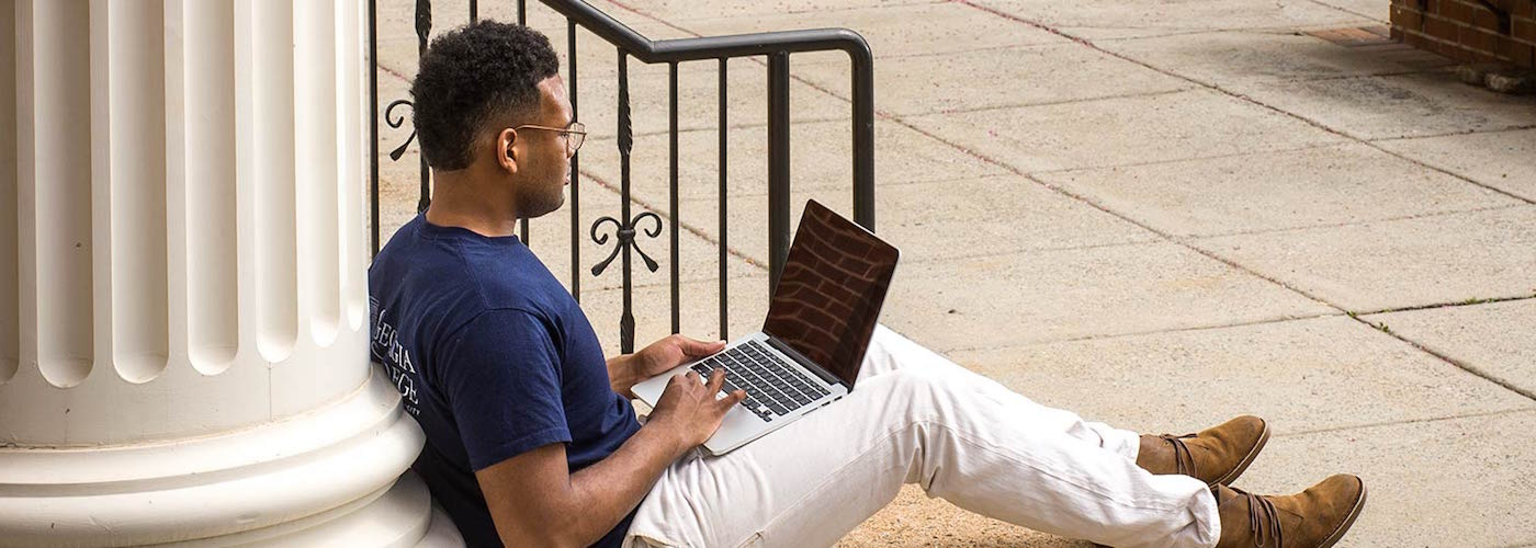 Graduate student on a laptop
