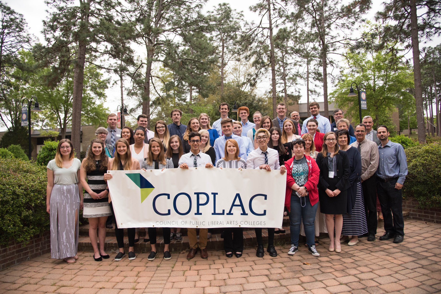 All COPLAC students in front of COPLAC banner