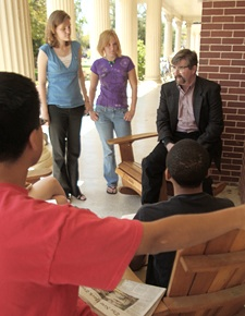Dr. Edmondson talking with students on the front porch of Terrell Hall.